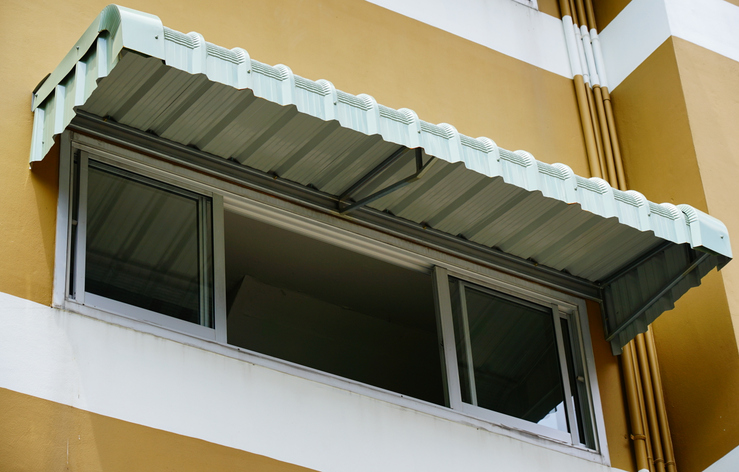 Metal awning over windows of condo